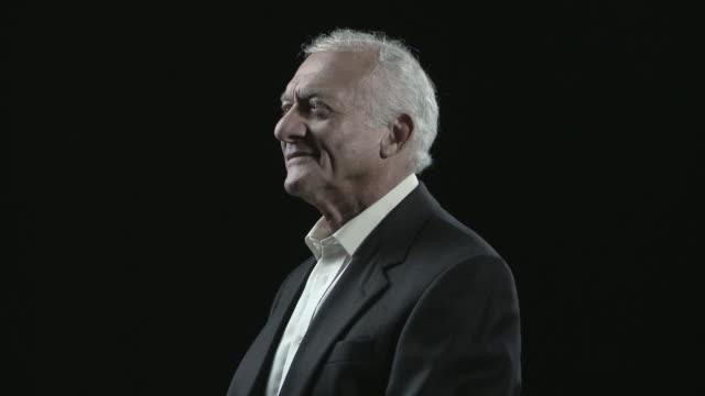 Portrait of senior man spinning