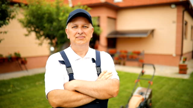 portrait of senior man with a lawn mower - mowing stock videos & royalty-free footage