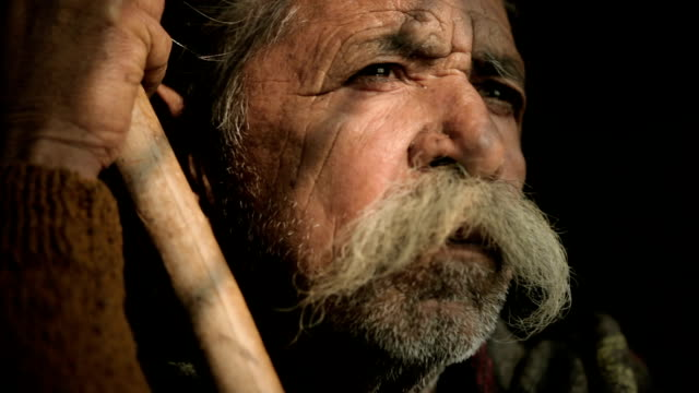 portrait of senior man with big mustache holding bamboo stick. - moustache stock videos and b-roll footage