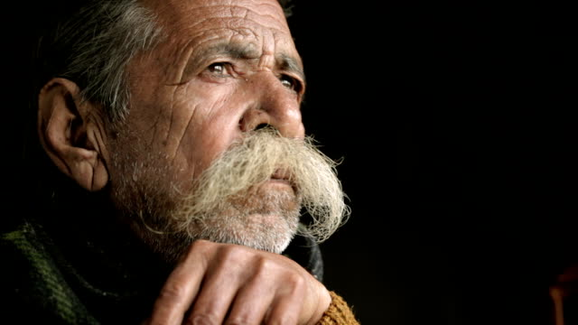 portrait of senior man with big mustache holding bamboo stick. - chin stock videos and b-roll footage