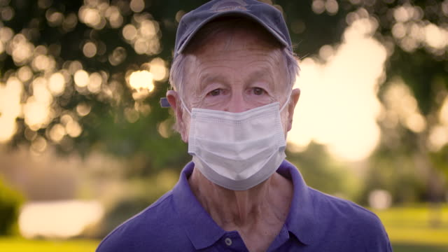 portrait of senior man with mask - one senior man only stock videos & royalty-free footage