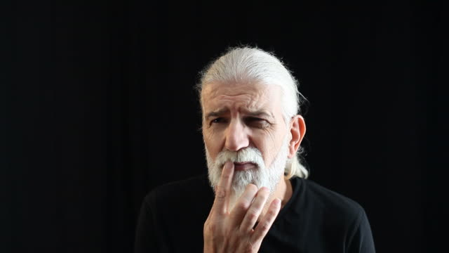 portrait of senior man with white hair and beard contemplating - white hair stock videos & royalty-free footage