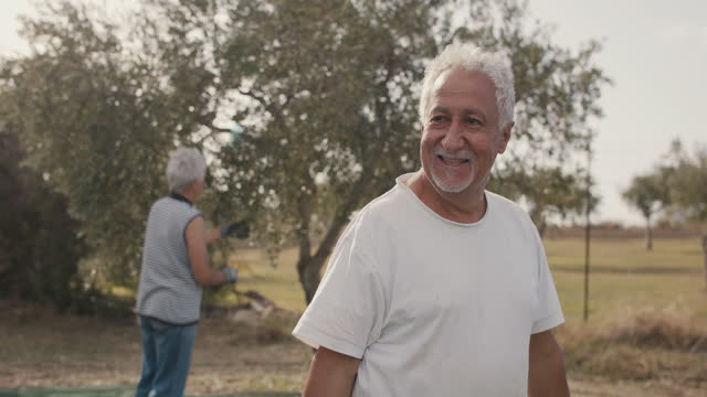 portrait of senior olive farmer in orchard - evergreen stock videos & royalty-free footage