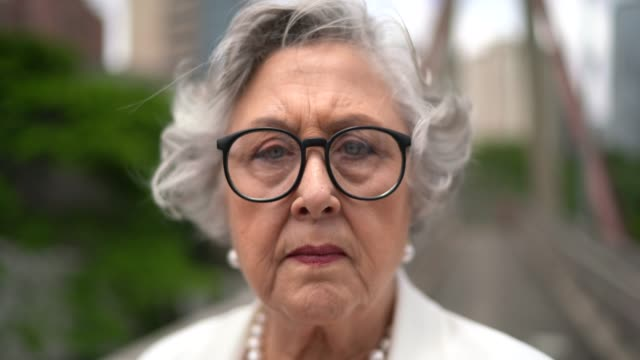 portrait of senior serious businesswoman at city - worried stock videos & royalty-free footage