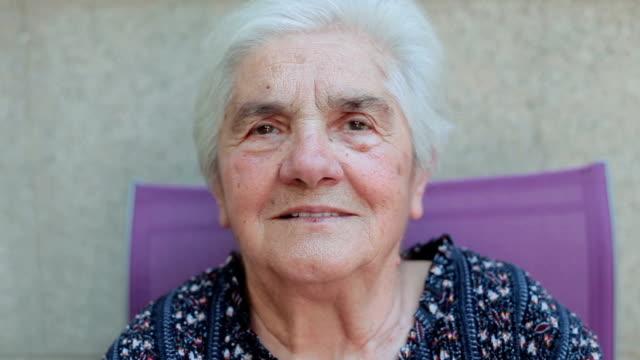 portrait of senior woman sitting outside