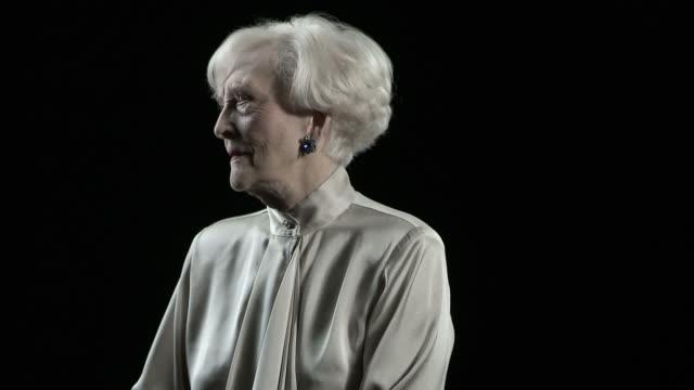 Portrait of senior woman spinning