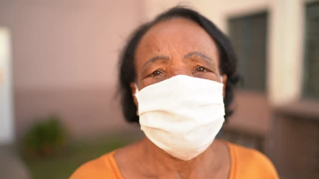 portrait of senior woman wearing face mask - aging process stock videos & royalty-free footage