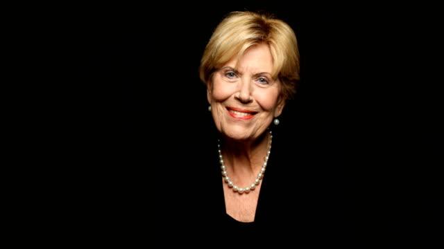 Portrait of senior woman wearing pearl jewelry