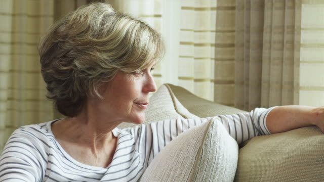 CU Portrait of senior women sitting on couch / Tenafly, New Jersey, USA