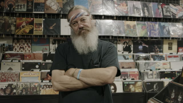 portrait of serious owner of record store / provo, utah, united states - kleinunternehmen stock-videos und b-roll-filmmaterial