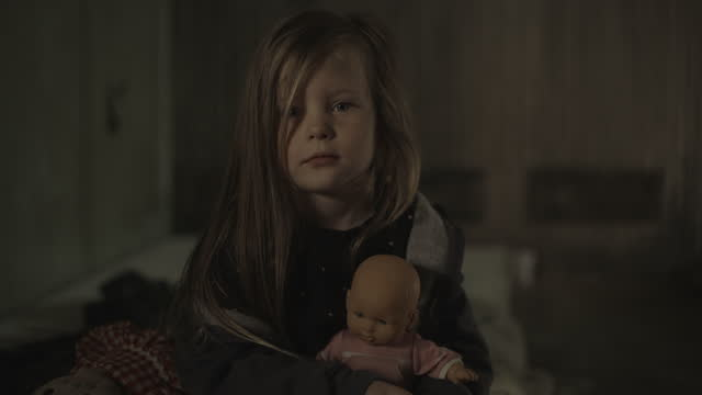 portrait of serious poor girl holding toy doll / cedar hills, utah, united states - headshot stock videos & royalty-free footage