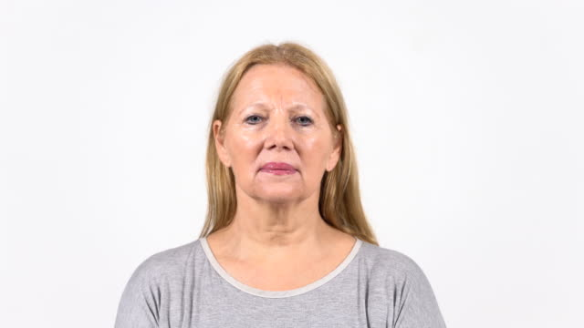 portrait of serious senior woman with blond hair - blank expression stock videos & royalty-free footage
