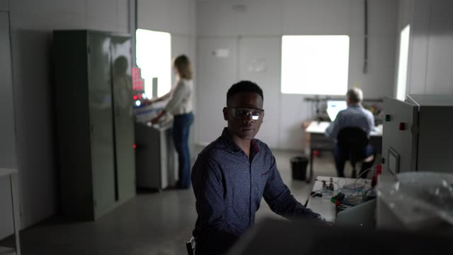 portrait of serious young employee looking at camera in industry - control room stock videos & royalty-free footage