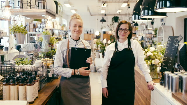 Portrait of Shop owner and assistant in a home decor shop (slow motion)