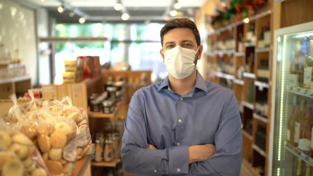 portrait of small business man owner with face mask - supermarket stock videos & royalty-free footage