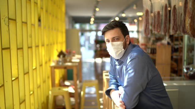 portrait of small business man owner with face mask - retail occupation stock videos & royalty-free footage