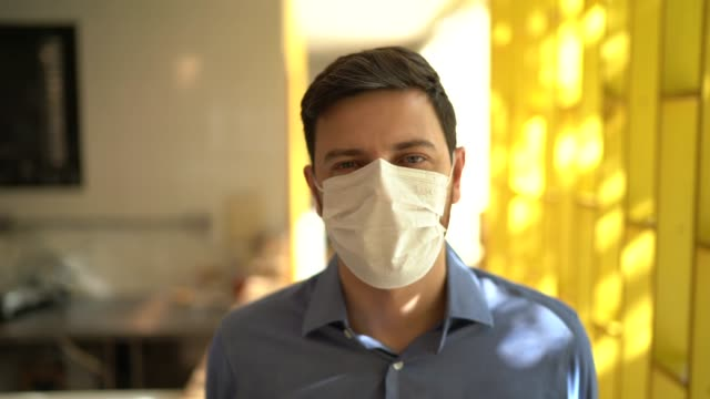 portrait of small business man owner with face mask - retail manager stock videos & royalty-free footage