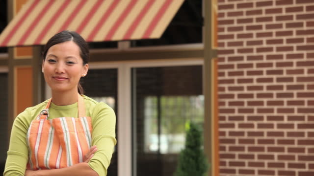 MS PAN Portrait of Small Business Owner in Front of Shop in Suburban Shopping Center / Richmond, Virginia, USA