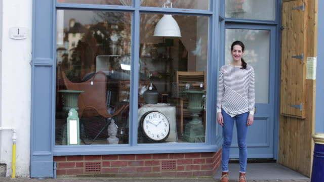 portrait of small business owner outside store - full length stock-videos und b-roll-filmmaterial