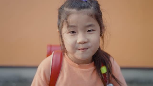 portrait of small cute elementary age school girl - headshot stock videos & royalty-free footage