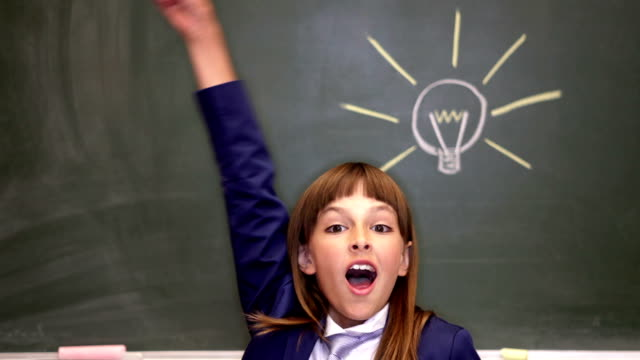 portrait of smart girl by the blackboard thinking of light idea - inspiration board stock videos and b-roll footage