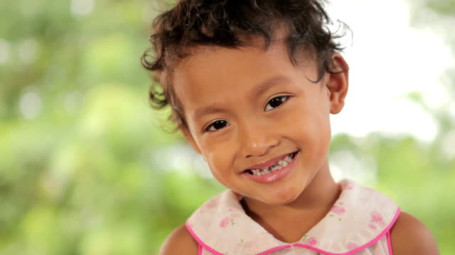 portrait of smile asian poor girl in thailand - orphan stock videos and b-roll footage