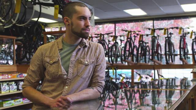 ms portrait of smiling bike shop employee / portland, oregon, usa - portland oregon bike stock videos & royalty-free footage