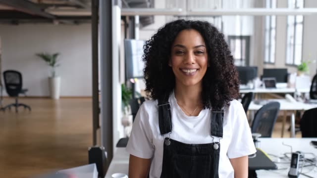 portrait of smiling businesswoman in bib overalls - bib overalls stock videos & royalty-free footage