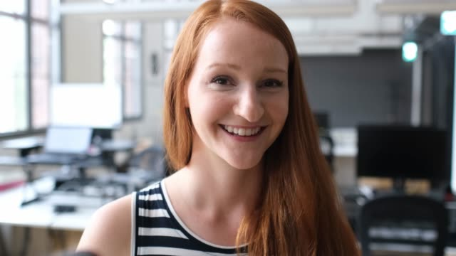 portrait of smiling businesswoman with redhead - redhead stock videos & royalty-free footage