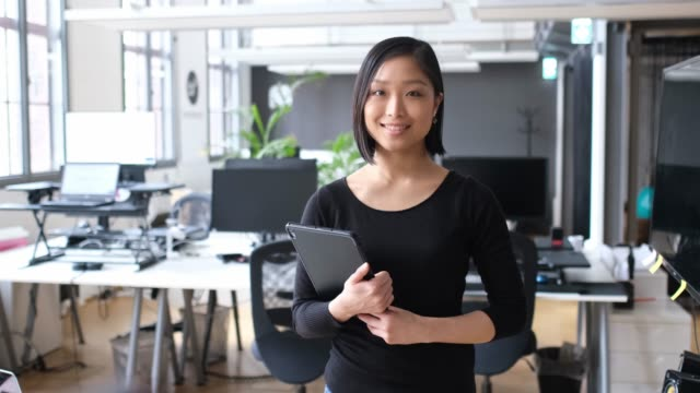 portrait of smiling businesswoman with tablet pc - east asian ethnicity stock videos & royalty-free footage