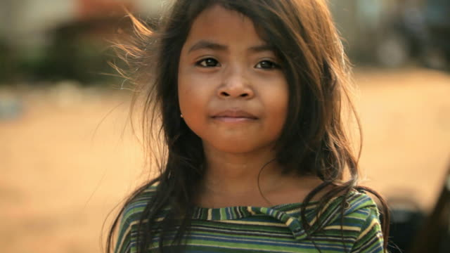 portrait of smiling cambodian girl - poverty stock videos & royalty-free footage