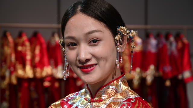 portrait of smiling chinese bride in traditional dress - gold dress stock videos & royalty-free footage
