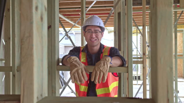 portrait of smiling construction worker at site - males stock videos & royalty-free footage