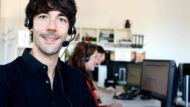 Portrait of smiling customer service representative in office