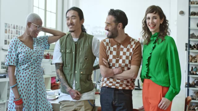 portrait of smiling design professionals at office - fashion designer stock videos and b-roll footage