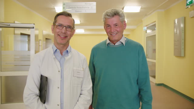 portrait of smiling doctor and patient in hospital - rehabilitation center stock videos & royalty-free footage