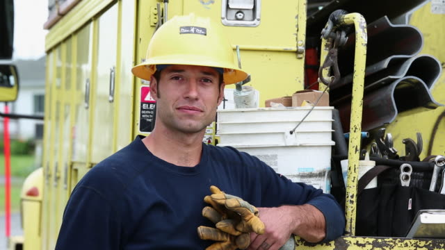 ms portrait of smiling electrical utility worker in saftey gear / oyster, virginia, usa - sicurezza video stock e b–roll