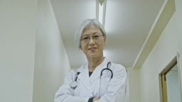 Portrait of Smiling Female Japanese Doctor at Corridor