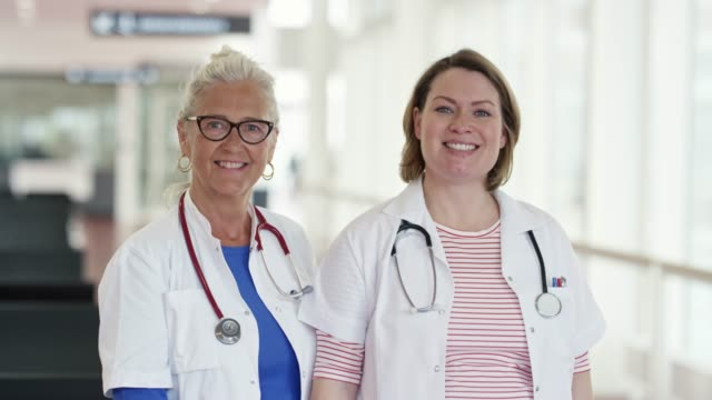portrait of smiling female medical professionals - coworker stock videos & royalty-free footage