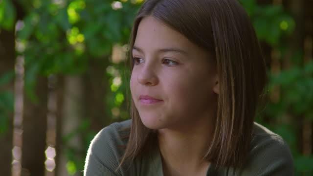 cu, portrait of smiling girl (10-11) in garden, hollywood, california, usa - 10 11 jahre stock-videos und b-roll-filmmaterial