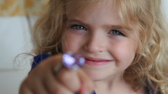 cu r/f portrait of smiling girl (4-5) with ring on her finger / jersey city, new jersey, usa - jewellery stock videos & royalty-free footage