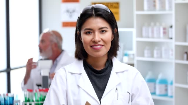portrait of smiling hispanic female scientist - scientist stock videos & royalty-free footage