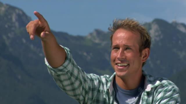 cu portrait of smiling man in alpine landscape, bavaria, germany - standbildaufnahme stock-videos und b-roll-filmmaterial