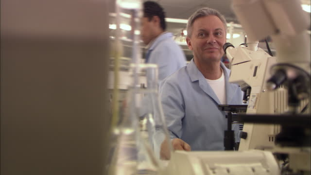 MS, SELECTIVE FOCUS, Portrait of smiling man in laboratory, London, England