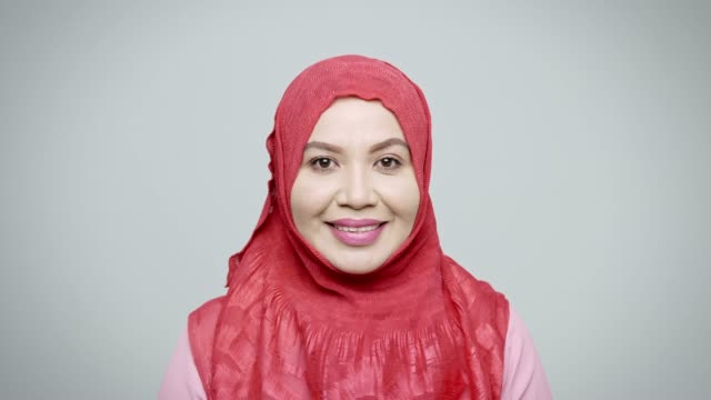 portrait of smiling mature businesswoman in hijab - white background stock videos & royalty-free footage