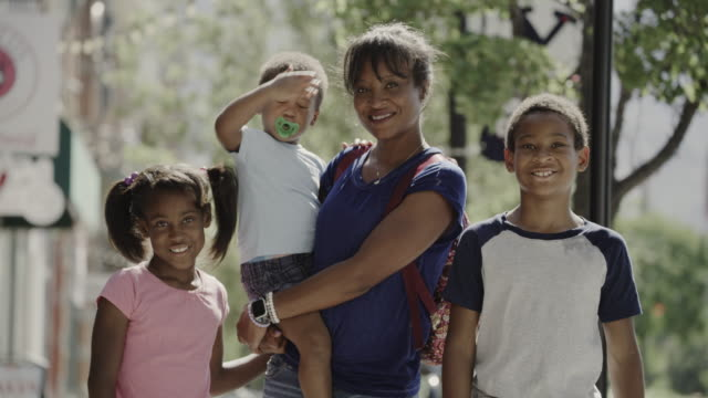 portrait of smiling mother and children posing in city / provo, utah, united states - provo stock videos & royalty-free footage