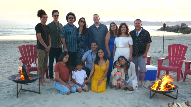 ms portrait of smiling multigenerational family on beach at sunset - pacific islander family stock videos & royalty-free footage