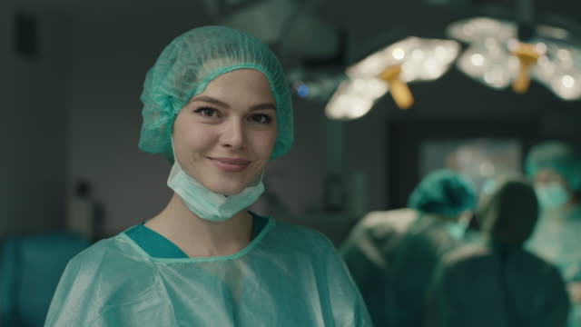 portrait of smiling nurse in operating room - surgical mask stock videos & royalty-free footage