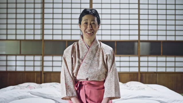 portrait of smiling owner kneeling on tatami mat - tatami mat stock videos and b-roll footage