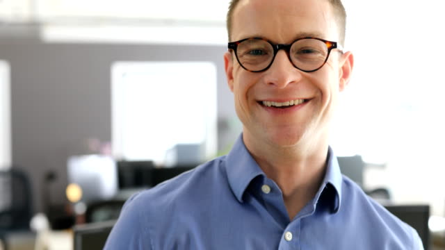 portrait of smiling professional at office - happy human face stock videos & royalty-free footage
